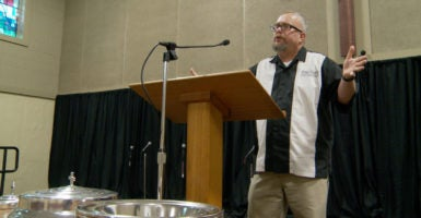 Michael Demastus, pastor of Fort Des Moines Church of Christ, at the pulpit.  The church has sued the state of Iowa to protect its right  to teach a biblical view of human sexuality.  (Photo courtesy of Alliance Defending Freedom)