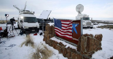 "A group of protesters occupied a federal building located on the Malheur National Wildlife Refuge. The FBI is leading the response, but former federal law enforcement officers say the agency is taking a ""wait and see"" approach, which differs from previous standoffs in Waco, Texas, and Ruby Ridge, Idaho. (Photo: Jim Urquhart/Reuters/Newscom)"