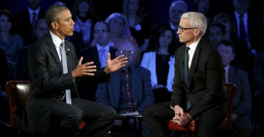 President Barack Obama participates in a live town hall event on reducing gun violence hosted by CNN's Anderson Cooper, right, at George Mason University. (Photo: Kevin Lamarque/Reuters/Newscom)