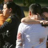 A couple embraces following a shooting rampage that killed at least 14 people and wounded 17 at Inland Regional Center in San Bernardino, Calif. (Photo: David Bauman/Zuma Press/Newscom)