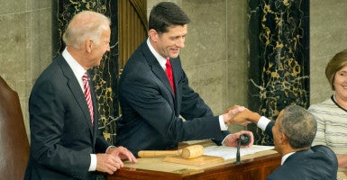 """On the offensive"": House Speaker Paul Ryan greets President Obama just before the State of the Union address Tuesday night. At left is Vice President Joe Biden. (Photo: Ron Sachs/DPA/Newscom)"