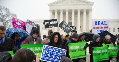 "Hundreds rally for religious freedom outside the Supreme Court  on March 25, 2014, during the Hobby Lobby case challenging Obamacare's mandates for religious employers.  ""It's not about access, it's about our beliefs and the sanctity of life,"" Geneva College official  Sue Thompson says in a new video. (Photo: Jeff Malet Photography/Newscom)"