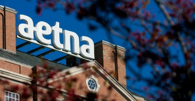 Insurance companies like Aetna say the special enrollment periods allowed for consumers under Obamacare are causing premiums to go up for consumers, as some people enroll in insurance during the special enrollment periods only to drop coverage months later. (Photo: Kris Tripplaar/Sipa USA/Newscom)