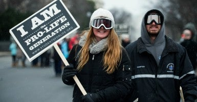 Two pro-life marchers in front of the Supreme Court. (Photo: Bill Clark/CQ Roll Call/Newscom)