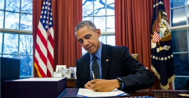 President Barack Obama signing the Omnibus budget bill on Dec. 18, 2015. (Photo: Jim Lo Sscalzo/Newscom)