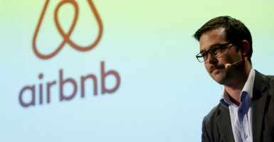 Mike Orgill, Airbnb's director of Public Policy in APAC, speaks during a news conference. (Yuya Shino/Reuters/Newscom)