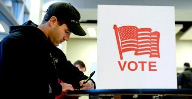 In case after case, critics challenging photo ID laws have used highly inflated statistics of voters who allegedly lack an acceptable form of photo ID for voting purposes. (Photo: Michael ReynoldsEPA/Newscom)