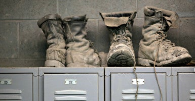 Coal mining boots rest atop miners' lockers before the afternoon shift at a coal mine near Gilbert, W.Va., in May 2014. (Photo: Robert Galbraith/Reuters/Newscom)