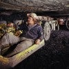 """Coal miners work underground in tight quarters. West Virginia and 26 other states say the Obama administration's """"clean power"""" rules will endanger their jobs and want the U.S. Supreme Court to hold up the plan. (Photo: Jim Pickerell/Newscom)"""