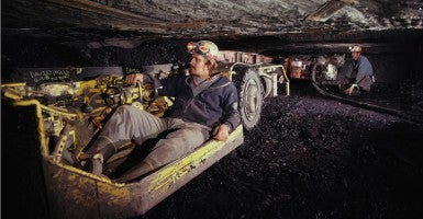 "Coal miners work underground in tight quarters. West Virginia and 26 other states say the Obama administration's ""clean power"" rules will endanger their jobs and want the U.S. Supreme Court to hold up the plan. (Photo: Jim Pickerell/Newscom)"