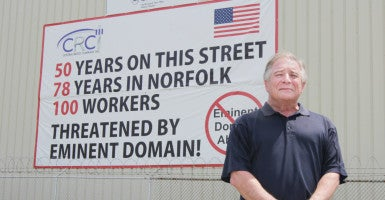 """It was pretty obvious to almost everybody that the city was attempting to stifle our speech,"" Bob Wilson, a co-owner of Central Radio, says. He is standing in front of the disputed sign. (Photo: Institute for Justice)"