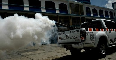 A Health Ministry car in Venezuela fumigates  mosquitos at a primary school in Caracas on Feb. 5, 2016. (Photo:Carlos Becerra/Polaris/Newscom)