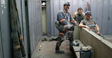 West Virginia miners prepare for the start of their shift. Last week, the Mountain State's legislature placed a right-to-work bill on the governor's desk. (Photo: Robert Galbrath/Reuters/Newscom)