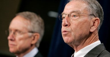 Democrats made good on a deal over Obama nominees negotiated by Sen. Chuck Grassley, R-Iowa, here with Senate Minority Leader Harry Reid. (Photo: Matthew Cavanaugh/EPA/Newscom)