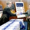 Printed copies of the President's budget are delivered to the Senate Budget Committee hearing room in the Dirksen Senate Office Building on Feb. 9. (Photo: Douliery/ABACAPRESS.COM)