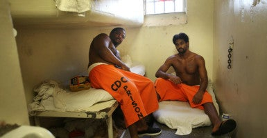 Sammy Featherstone, left, and Ben Turner share a cell meant for a single prisoner at the California Correctional Institute for Men. Advocates of relaxing mandatory minimum sentences are trying to round up enough votes in the Senate.  (Photo: Patrick Tehan/MCT/Newscom)