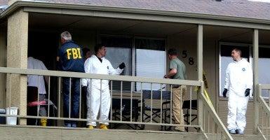 Federal authorities search an apartment in Boise, Idaho on May 16 2013 in relation to the arrest of Fazliddin Kurbanov. (Photo: Joe Jaszewski/Idaho Statesman/MCT/Newscom)
