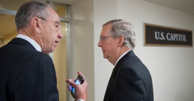 Sen. Chuck Grassley, R-Iowa, and Majority Leader Mitch McConnell, R-Ky., are trying to keep Senate Republicans united in opposition to confirming a Supreme Court nominee under President Obama. (Photo: Douglas Graham/CQ Roll Call Photos/Newscom)
