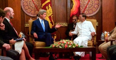 U.S. Secretary of State John Kerry chats with Sri Lankan President Maithripala Sirisena after meeting with Sri Lankan Foreign Minister Mangala Samaraweera in Colombo, Sri Lanka, on May 2, 2015. (Photo: State Department/Sipa USA/Newscom)