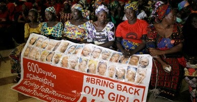 "Parents of the Chibok girls hold a ""Bring Back Our Girls"" banner during their meeting with Nigeria's President Muhammadu Buhari at the presidential villa in Abuja, Nigeria, Jan. 14.(Photo: Aflobai SOTUNDE/ REUTERS/ Newscom)"