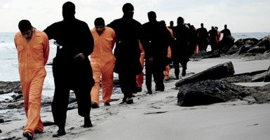 ISIS militants march a dozen Egyptian Coptic Christians along a Libyan beach before beheading them in a mass murder Feb. 19, 2015. (Photo: Al-Hayat Media/Zuma Press /Newscom)