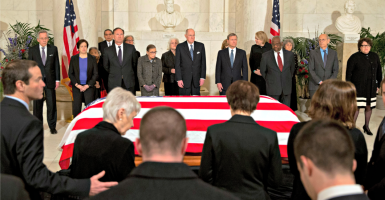 Antonin Scalia's family takes seats during a private ceremony Feb. 19 in the Great Hall of the Supreme Court as the remaining justices stand before his casket. From back left:  Elena Kagan, Samuel  Alito, Ruth Bader Ginsburg, Anthony Kennedy,  John Roberts, Clarence Thomas, Stephen Breyer and Sonia Sotomayor. (Photo: Polaris/Newscom)