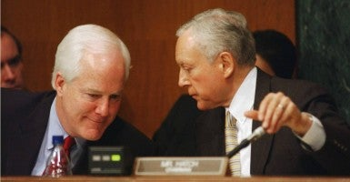 Sens. John Cornyn, R-Texas, left, and Orrin Hatch, R-Utah, huddle during a Judiciary Committee hearing. Not all of President Obama's federal court nominees will be frozen out, Cornyn says. (Photo: Scott J. Ferrell/Congressional Quarterly/Newscom)