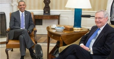 Majority Leader Mitch McConnell meets with President Obama in the Oval Office. McConnell met with House Republicans earlier to assure them he'll make good on his promise not to confirm an Obama nominee to the Supreme Court. (Photo: Michael Reynolds/EPA/Newscom)