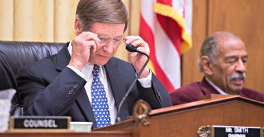 Rep. Lamar Smith, R-Texas, at left during a 2012 House committee meeting,   says a university professor's finances related to the climate change debate are cause for taxpayer concern. (Photo: Tom Williams/CQ Roll Call/Newscom)
