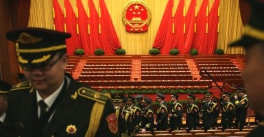 Members of the Chinese military band leave the hall after the opening of the fourth Session of the 12th National People's Congress (NPC) at the Great Hall of the People in Beijing, China on March 5th. (Photo: How Hwee Young/EPA/Newscom)