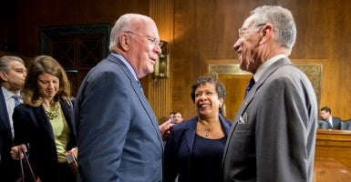 Sens. Chuck Grassley, R-Iowa (right), and Pat Leahy, D-Vt., chat on March 19, 2015, after a Judiciary Committee battle over confirming Attorney General Loretta Lynch. (Photo: Bill Clark/CQ Roll Call/Newscom)