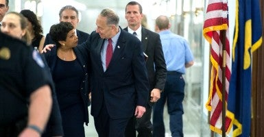 Attorney General Loretta Lynch speaks with Sen. Chuck Schumer, D-N.Y., as they arrive for the Senate Judiciary Committee hearing. (Photo: Bill Clark/CQ Roll Call/Newscom)