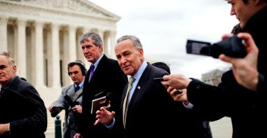 Sen. Charles Schumer, D-N.Y., leaves a news conference with other Senate Democrats outside of the Supreme Court to call on Senate Republicans to allow a hearing and vote on President Barack Obama's nominee. (Photo: Tom Williams/CQ Roll Call/Newscom)
