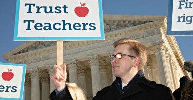 Tyler Koteskey, an education policy analyst at Reason Foundation, a free market think tank, supports nonunion teachers Jan. 11 outside the Supreme Court.  (Photo: Jeff Malet/SIPA/Newscom)