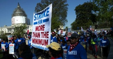 A recent poll of D.C. business owners found more than half of them plan to eliminate jobs if the minimum wage rises to $15. In fact they may already be happening. (Photo: Kevin Dietsch/UPI/Newscom)