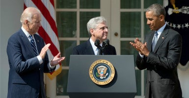 President Barack Obama and Vice President Joe Biden celebrate Supreme Court nominee Merrick Garland. (Photo: Douliery Olivier/Sipa USA/Newscom)