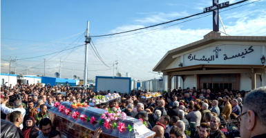 Christian Kurds carry the coffins containing 6 Iraqi Christian family members. The Christian population in Iraq has declined from 1.4 million in 2003, to only 275,000 today. (Photo: Marcos Andronicou/SIPA/Newscom)