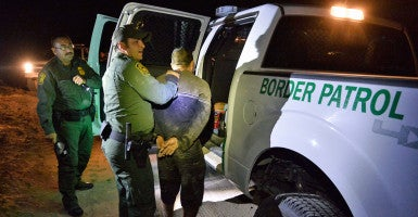 U.S. Border Patrol agents search a person suspected of crossing the Rio Grande River to enter the United States illegally near McAllen, Texas, earlier this month. The nearly 2,000-mile border with Mexico is the most frequently crossed international border in the world. (Photo: Larry W. Smith/EPA/Newscom)