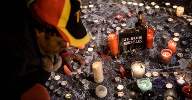 People light candles at the Place de la Bourse during a vigil to pay tribute to the victims of the attacks in Brussels, Belgium. (Photo: Christophe Petit Tesson/EPA/Newscom)