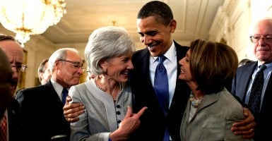 President Barack Obama on March 23, 2010 with Secretary of Health and Human Services Kathleen Sebelius and House Speaker Nancy Pelosi after signing the Affordable Care Act.  (Photo: Pete Souza/ZUMA Press/Newscom)
