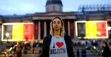 A mourner visiting Trafalgar Square whilst a projection of the Belgian flag is beamed onto the National Gallery in London to pay tribute to Brussels terror victims on Wednesday, March 23. (Photo: Tolga Akmen/ZUMA Press/Newscom)