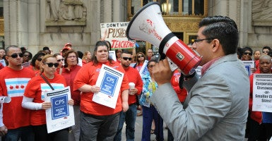 Chicago teachers and supporters protest outside City Hall on July 2, 2015. (Photo: Patrick Gorski/NurPhoto/Sipa USA/Newscom)
