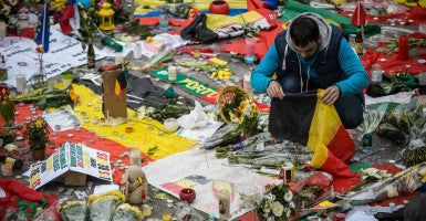 The Belgian flag is a common part of tributes paid to those who died and were wounded in multiple terrorist attacks March 22 in Brussels. (Photo: Christophe Petit/Tesson/EPA /Newscom)