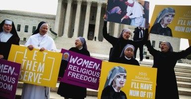 They were there to hear the U.S. government argue that the Little Sisters of the Poor must violate their faith and assist in providing contraceptive drugs and devices (including abortifacients) for all of their nuns and any other employees—through their health care plans.  (Photo: Jim Lo Scalzo/EPA/Newscom)