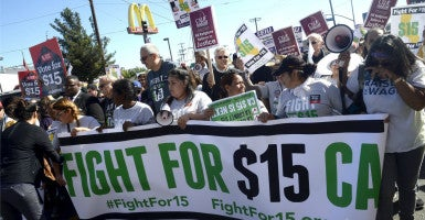 California Gov. Jerry Brown announced a plan today to raise the minimum wage to $15 an hour by 2022. Labor experts warn the wage hike could lead to higher prices and more automation for consumers. (Photo: Mike Nelson/EPA/Newscom)