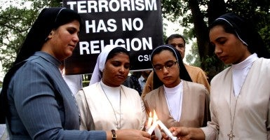 Pakistani Christians light candles for suicide blast victims during a vigil ceremony in eastern Pakistan's Lahore on March 28. (Photo: Jamil Ahmed Xinhua News Agency/Newscom)