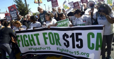 Hundreds gather to demand a $15 minimum wage increase in downtown Los Angeles, Calif., November 2015. (Photo: Mike Nelson/EPA/Newscom)