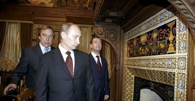 Dmitry Medvedev and then Vladimir Putin with Sergei Roldugin. Roldugin is at the centre of a scheme in which money from Russian state banks is hidden offshore. (Photo: Sputnik/Reuters/Newscom)