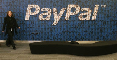 A staff member at a PayPal branch in Ireland. Dan Schulman, PayPal's president and CEO, says the company won't expand in North Carolina because of a new law. (Photo: Niall Carson/ZUMA Press/Newscom)