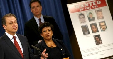 Manhattan U.S. Attorney Preet Bharara, FBI Director James Comey and U.S. Attorney General Loretta Lynch, announce indictments on Iranian hackers. (Photo: Jonathan Ernst/Reuters/Newscom)